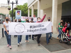 Members of the Surgentes human rights collective march near the Venezuelan National Assembly